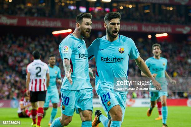 Lionel Messi of FC Barcelona celebrates with his teammate Andre Gomes of FC Barcelona after scoring the opening goal during the La Liga match between...