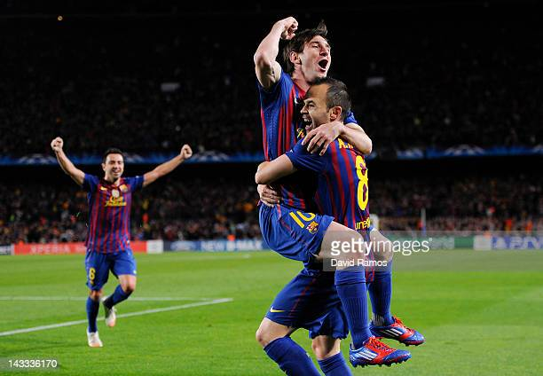 Lionel Messi of FC Barcelona celebrates with his teammate Andres Iniesta after Iniesta scored their team's second goal during the UEFA Champions...