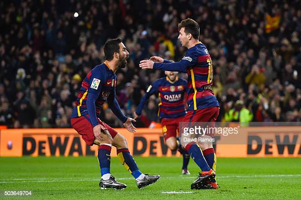 Lionel Messi of FC Barcelona celebrates with his teammate Arda Turan of FC Barcelona after scoring the opening goal during the Copa del Rey Round of...