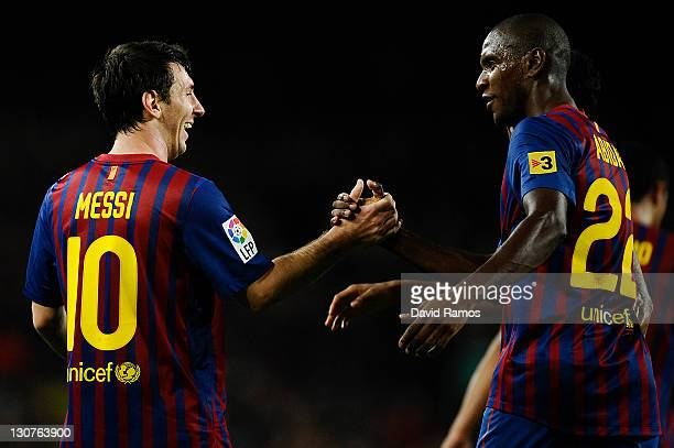 Lionel Messi of FC Barcelona celebrates with his teammate Eric Abidal of FC Barcelona after scoring his third team's goal during the La Lliga match...
