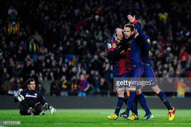 Lionel Messi of FC Barcelona celebrates with his teammate Jordi Alba and Cesc Fabregas after scoring his team's fifth goal during the La Liga match...