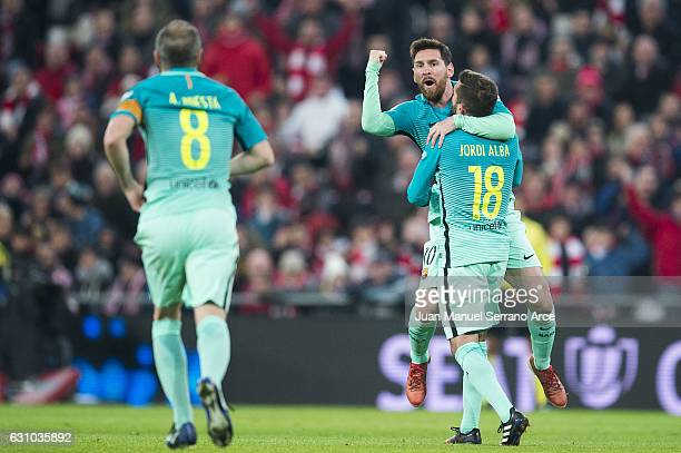 Lionel Messi of FC Barcelona celebrates with his teammate Jordi Alba of FC Barcelona after scoring their opening goal during the Copa del Rey Round...