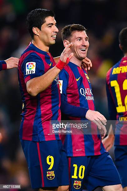Lionel Messi of FC Barcelona celebrates with his teammate Luis Suarez of FC Barcelona after scoring his team's fifth goal during the La Liga match...