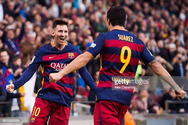 Lionel Messi of FC Barcelona celebrates with his teammate Luis Suarez after scoring the opening goal during the La Liga match between FC Barcelona...