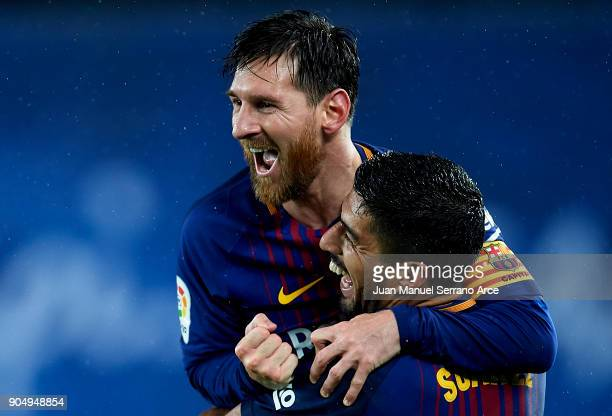 Lionel Messi of FC Barcelona celebrates with his teammate Luis Suarez of FC Barcelona after scoring his team's fourth goal during the La Liga match...
