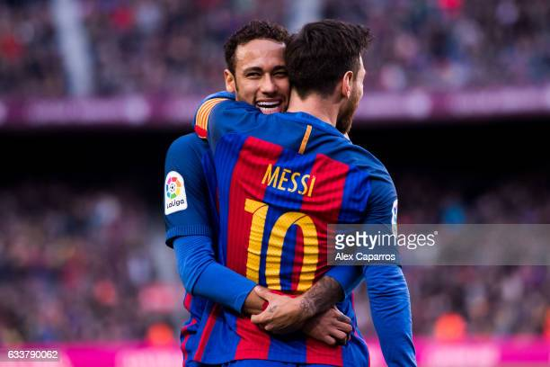 Lionel Messi of FC Barcelona celebrates with his teammate Neymar Santos Jr after scoring his team's second goal during the La Liga match between FC...
