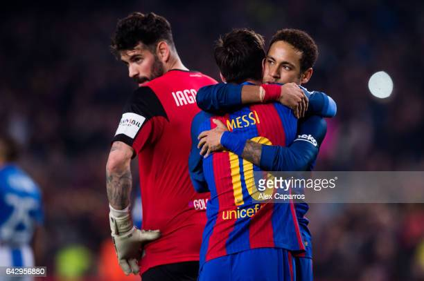 Lionel Messi of FC Barcelona celebrates with his teammate Neymar Santos Jr and next to goalkeeper Iago Herrerin of CD Leganes after kicking a penalty...