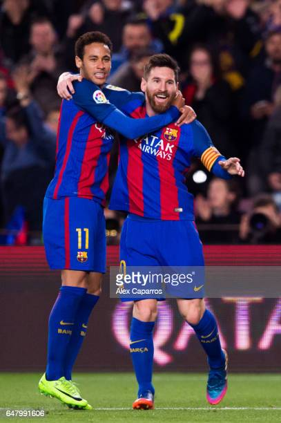 Lionel Messi of FC Barcelona celebrates with his teammate Neymar Santos Jr after scoring the opening goal during the La Liga match between FC...