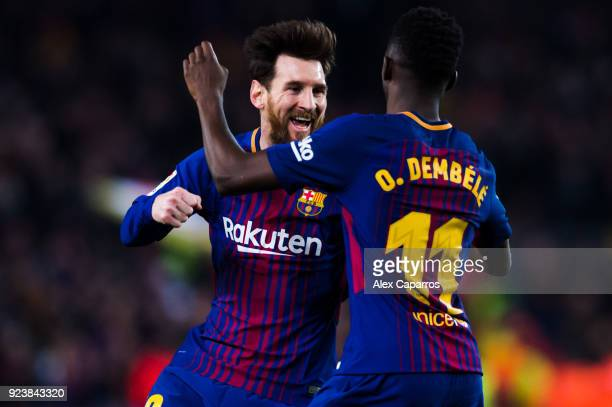 Lionel Messi of FC Barcelona celebrates with his teammate Ousmane Dembele after scoring his team's third goal during the La Liga match between...