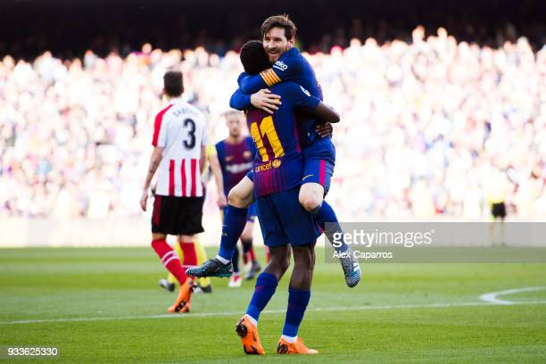 Lionel Messi of FC Barcelona celebrates with his teammate Ousmane Dembele after scoring his team's second goal during the La Liga match between...