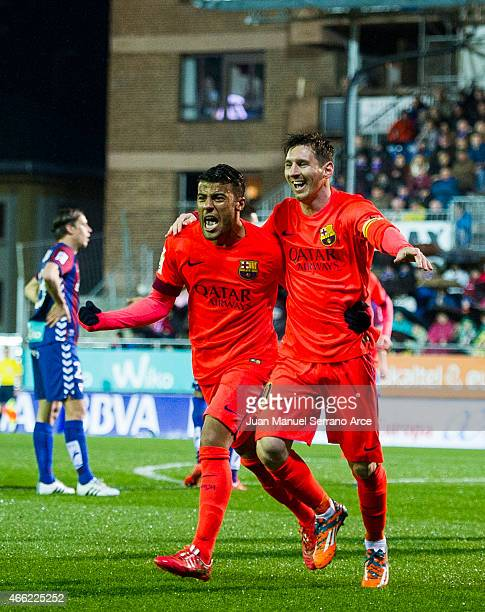 Lionel Messi of FC Barcelona celebrates with his teammate Rafinha of FC Barcelona after scoring his goal during the La Liga match between SD Eibar...