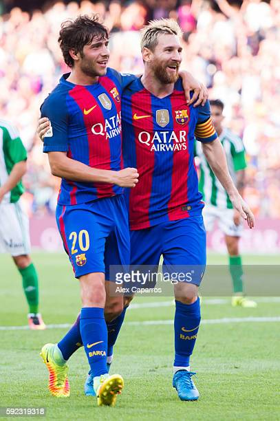 Lionel Messi of FC Barcelona celebrates with his teammate Sergi Roberto after scoring his team's second goal during the La Liga match between FC...