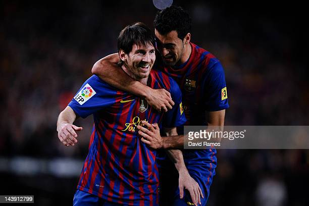 Lionel Messi of FC Barcelona celebrates with his teammate Sergio Busquets of FC Barcelona after scoring the opening goal during the La Liga match...