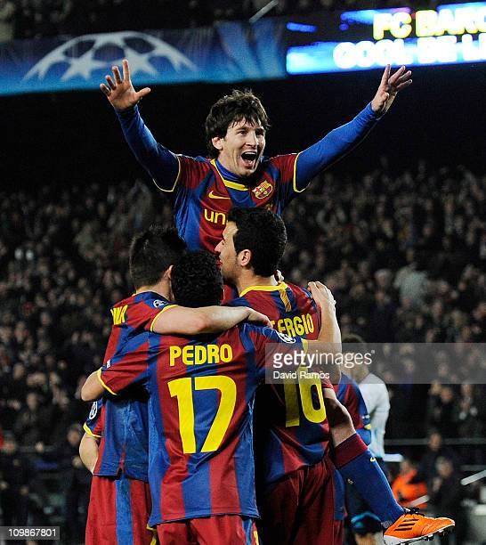 Lionel Messi of FC Barcelona celebrates with his teammates after scoring his second goal during the UEFA Champions League round of 16 second leg...