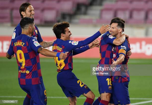 Lionel Messi of FC Barcelona celebrates with his teammates after scoring his team's second goal by penalty against Goalkeeper Jan Oblak of Atletico...