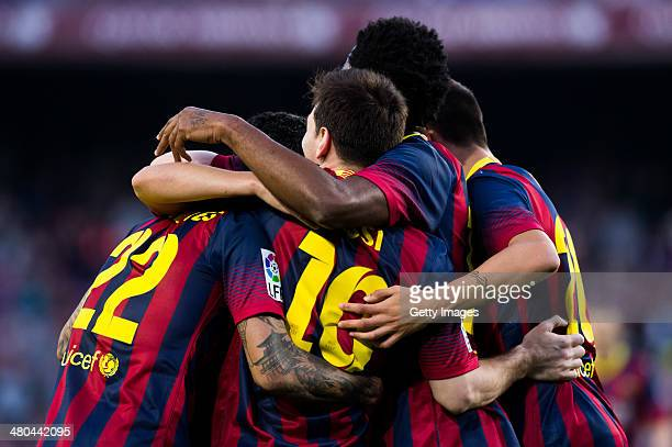 Lionel Messi of FC Barcelona celebrates with his teammates after scoring his team's sixth goal during the La Liga match between FC Barcelona and CA...