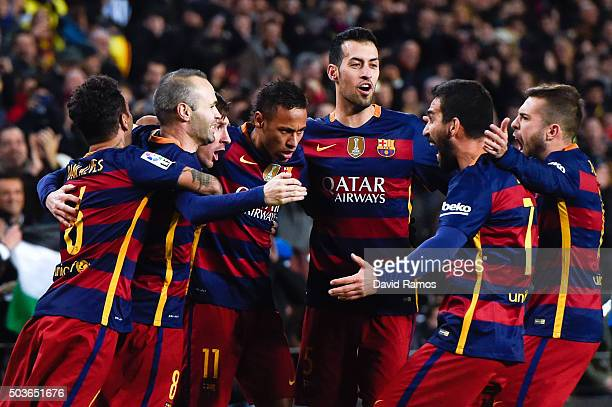 Lionel Messi of FC Barcelona celebrates with his teammates after scoring his team's second goal during the Copa del Rey Round of 16 first leg match...
