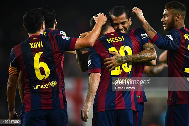 Lionel Messi of FC Barcelona celebrates with his teammates after scoring the opening goal during the La Liga mach between FC Barcelona and Sevilla FC...