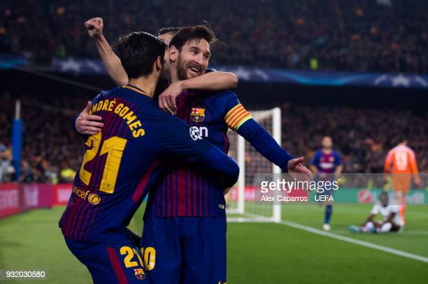 Lionel Messi of FC Barcelona celebrates with his teammates Andre Gomes and Jordi Alba after scoring his team's third goal during the UEFA Champions...