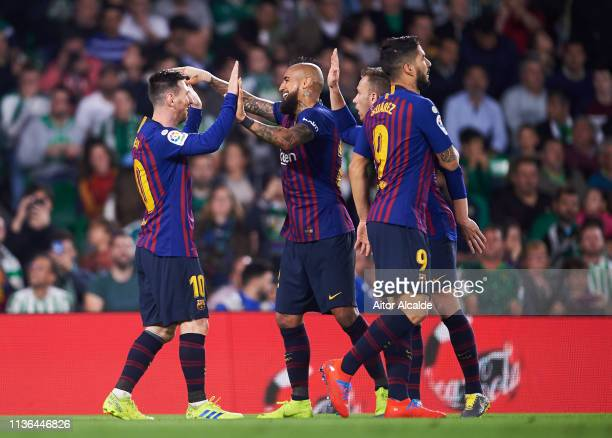Lionel Messi of FC Barcelona celebrates with his teammates Arturo Vidal and Arthur Melo of FC Barcelona after scoring his team's second goal during...