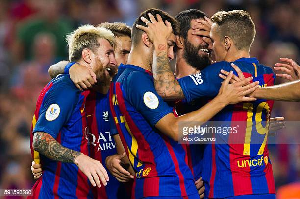 Lionel Messi of FC Barcelona celebrates with his teammates Denis Suarez Munir El Haddadi Arda Turan and Lucas Digne after scoring his team's third...