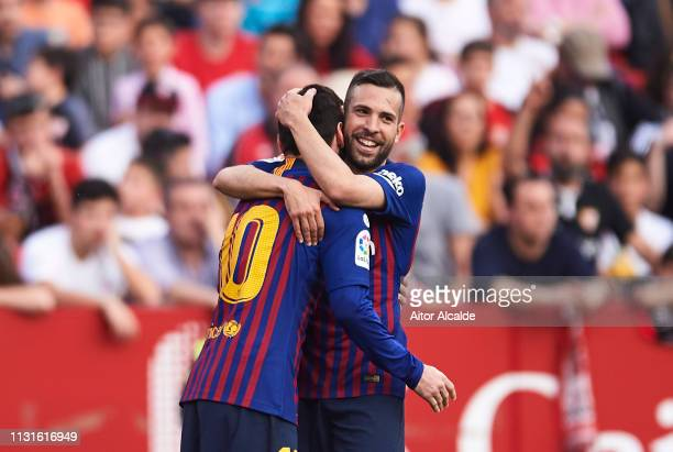 Lionel Messi of FC Barcelona celebrates with his teammates Jordi Alba of FC Barcelona after scoring his team's third goal during the La Liga match...