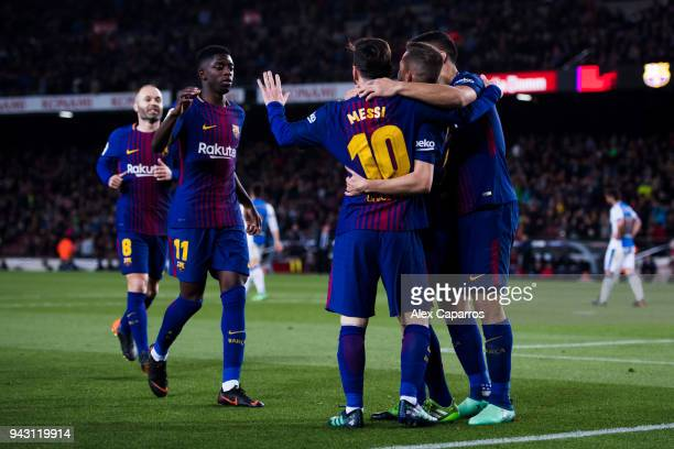Lionel Messi of FC Barcelona celebrates with his teammates Jordi Alba Luis Suarez Ousmane Dembele and Andres Iniesta after scoring his team's third...
