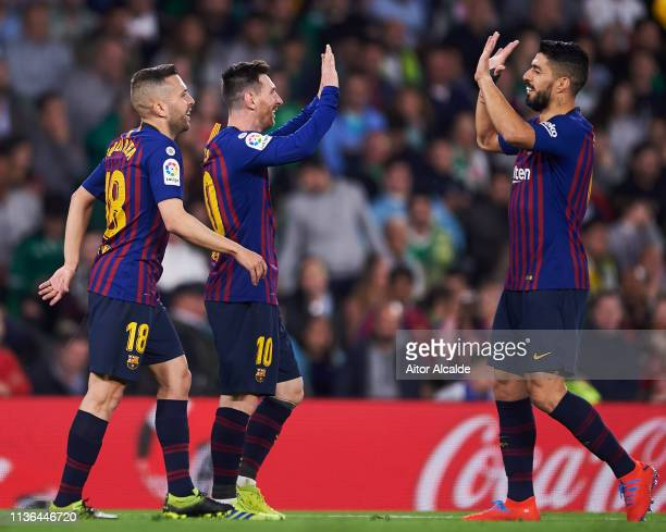 Lionel Messi of FC Barcelona celebrates with his teammates Luis Suarez and Jordi Alba of FC Barcelona after scoring his team's second goal during the...