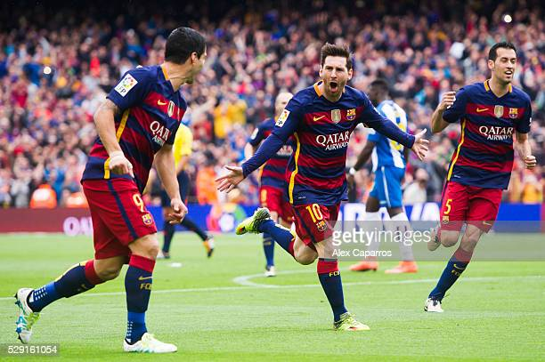 Lionel Messi of FC Barcelona celebrates with his teammates Luis Suarez and Sergio Busquets after scoring the opening goal during the La Liga match...