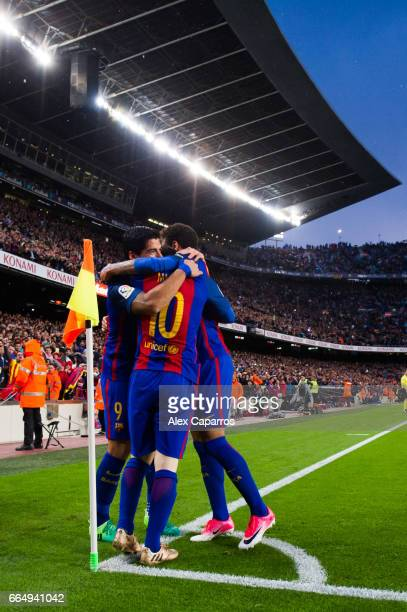 Lionel Messi of FC Barcelona celebrates with his teammates Luis Suarez and Neymar Santos Jr after scoring his team's second goal during the La Liga...