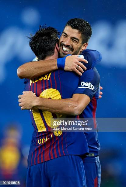 Lionel Messi of FC Barcelona celebrates with his teammates Luis Suarez of FC Barcelona after scoring his team's fourth goal during the La Liga match...