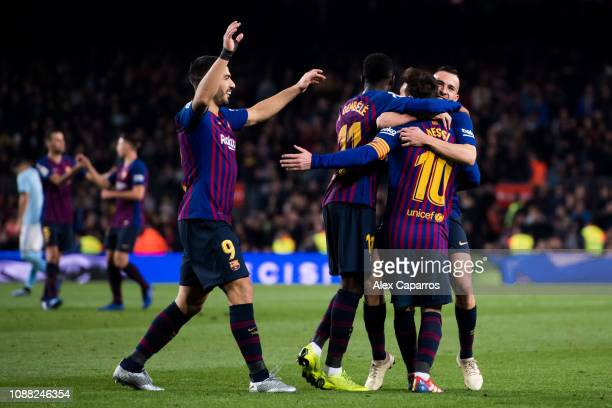 Lionel Messi of FC Barcelona celebrates with his teammates Luis Suarez Ousmane Dembele and Jordi Alba after scoring his team's second goal during the...