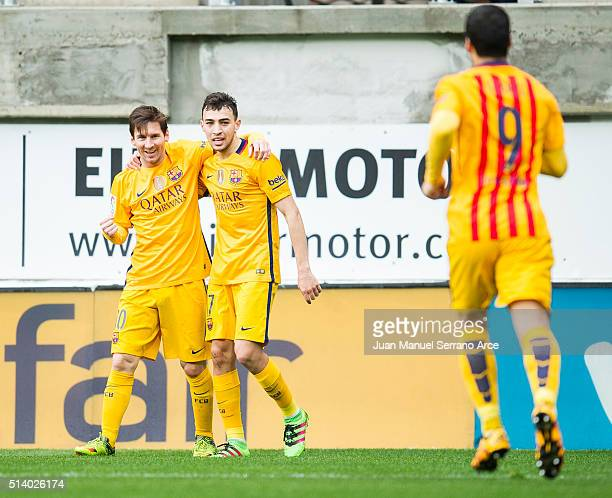 Lionel Messi of FC Barcelona celebrates with his teammates Munir El Haddadi of FC Barcelona after scoring his team's second goal during the La Liga...