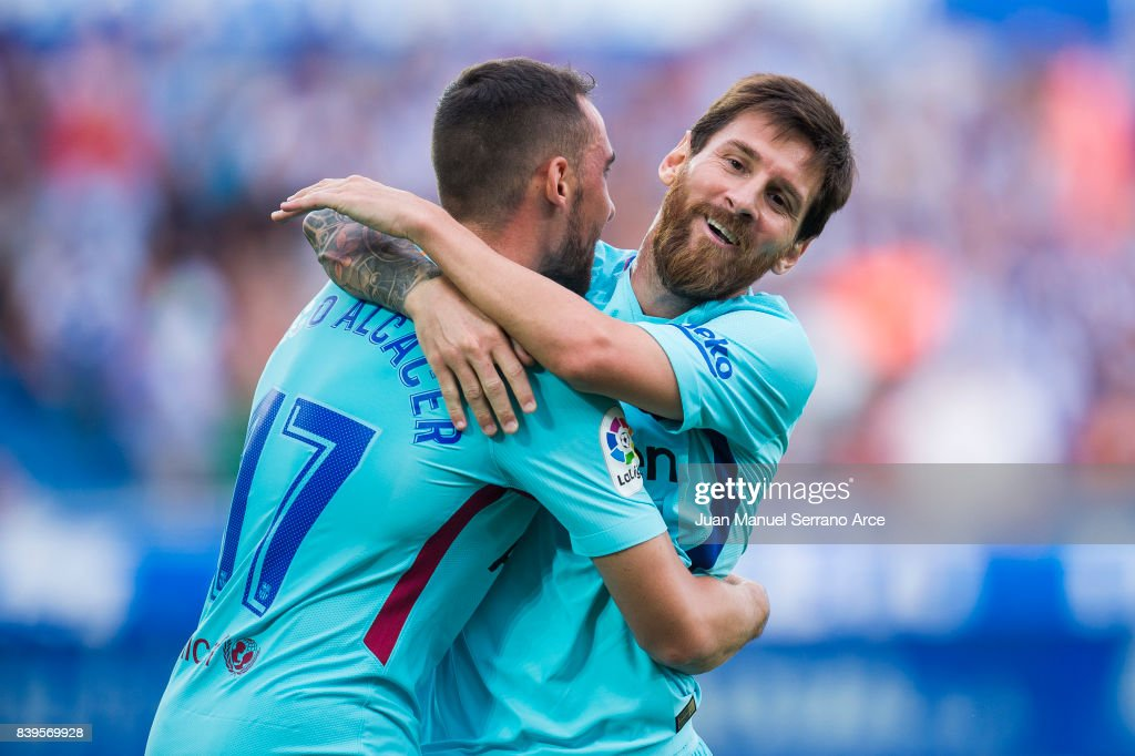 Lionel Messi of FC Barcelona celebrates with his teammates Paco Alcacer of FC Barcelona after scoring his team's second goal during the La Liga match between Deportivo Alaves and Barcelona at Estadio de Mendizorroza on August 26, 2017 in Vitoria-Gasteiz, Spain.