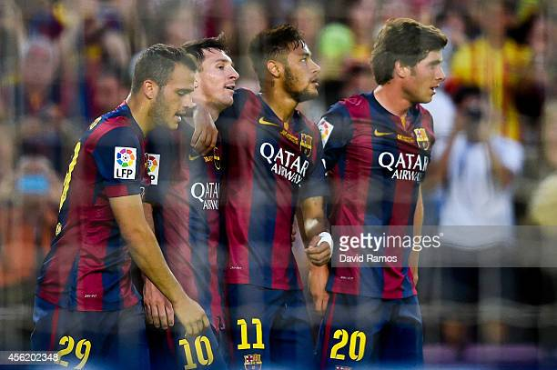 Lionel Messi of FC Barcelona celebrates with his teammates Sandro Neymar and Sergio Roberto of FC Barcelona after scoring his team's sixth goal...