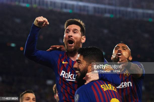 Lionel Messi of FC Barcelona celebrates with Luis Suarez and Arturo Vidal scoring his sides second goal during the UEFA Champions League Semi Final...