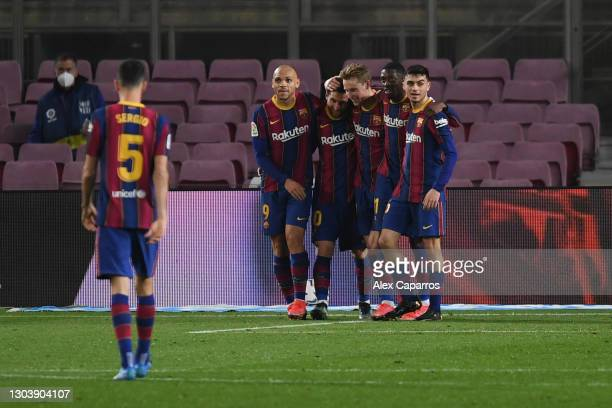 Lionel Messi of FC Barcelona celebrates with Martin Braithwaite and team mates after scoring their side's second goal during the La Liga Santader...
