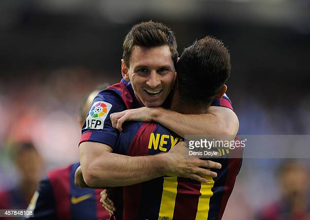 Lionel Messi of FC Barcelona celebrates with Neymar after Neymar scored his team's opening goal during the La Liga match between Real Madrid CF and...
