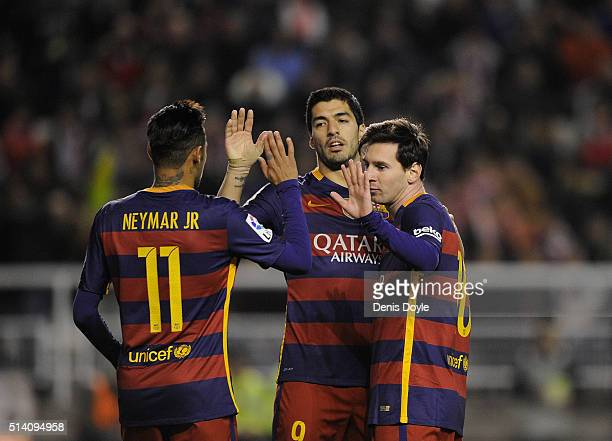 Lionel Messi of FC Barcelona celebrates with Neymar and Luis Suarez after scoring his 2nd goal during the La Liga match between Rayo Vallecano and FC...