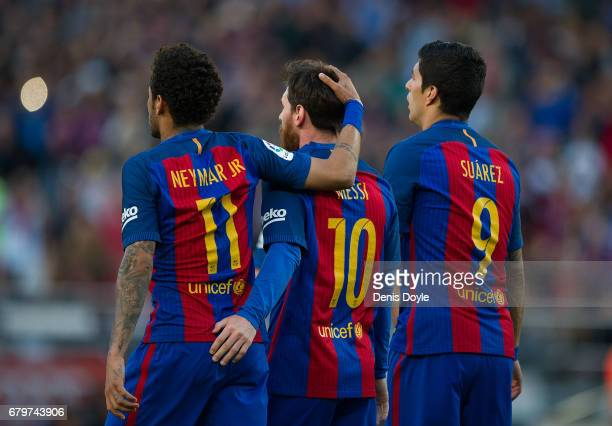Lionel Messi of FC Barcelona celebrates with Neymar and Luis Suarez after scoring his team's 3rd goal from the penalty spot during of the La Liga...