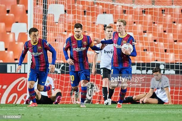 Lionel Messi of FC Barcelona celebrates with team mate Frenkie de Jong and Dest after scoring their side's first goal during the La Liga Santander...