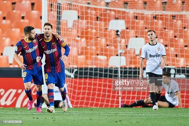 Lionel Messi of FC Barcelona celebrates with team mate Jordi Alba after scoring their side's first goal during the La Liga Santander match between...