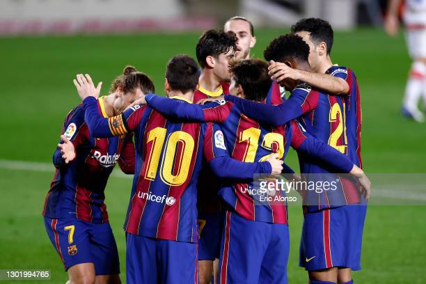 Lionel Messi of FC Barcelona celebrates with team mates after scoring their side's second goal during the La Liga Santander match between FC...