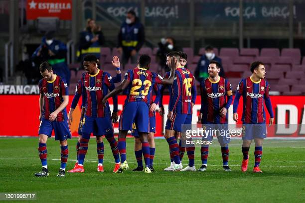 Lionel Messi of FC Barcelona celebrates with team mates after scoring their side's fourth goal during the La Liga Santander match between FC...