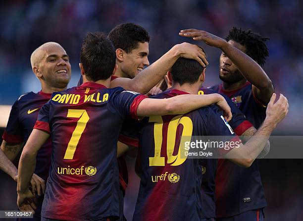 Lionel Messi of FC Barcelona celebrates with team mates after scoring Barcelona's 2nd goal during the La Liga match between RC Celta de Vigo and FC...