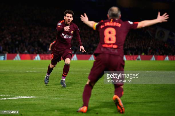 Lionel Messi of FC Barcelona celebrates with teammate Andres Iniesta after scoring his sides first goal during the UEFA Champions League Round of 16...