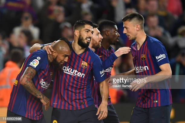Lionel Messi of FC Barcelona celebrates with teammates after scoring his team's first goal during the La Liga match between FC Barcelona and Levante...