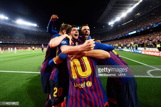 Lionel Messi of FC Barcelona celebrates with teammates after scoring his sides second goal during the UEFA Champions League Semi Final first leg...
