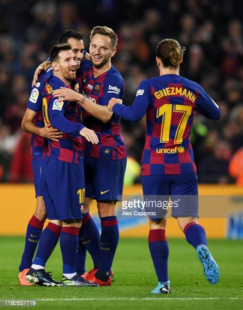 Lionel Messi of FC Barcelona celebrates with teammates after scoring his team's second goal during the Liga match between FC Barcelona and RCD...