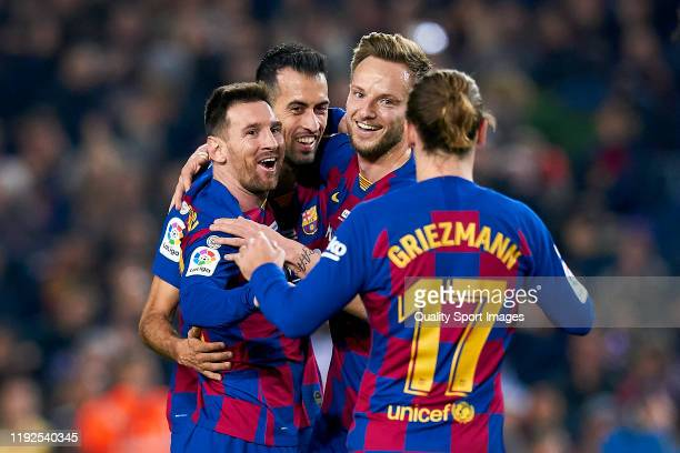Lionel Messi of FC Barcelona celebrates with teammates after scoring during the Liga match between FC Barcelona and RCD Mallorca at Camp Nou on...
